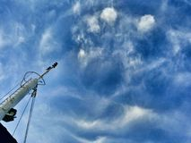 Reception antenna with clouds and blue sky Stock Image