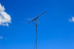 Antenna in blue sky. Tv antenna in blue sky Stock Images