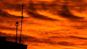 Antenna burning sunset. Silhouette of TV antenna against the background of a burning sunset stock footage