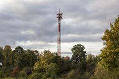 Antenna and cell phone cellular towers on a mountaintop on a clear dayin autumn. Stock Photo