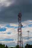 Antenna of cellular and communication system tower with the blue Stock Photography