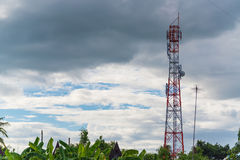 Antenna of cellular and communication system tower with the blue Stock Photo