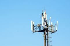 Antenna cellular networks against the blue clear sky Stock Photos