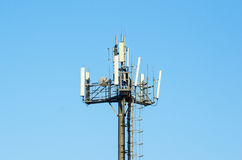 Antenna cellular networks against the blue clear sky. Modern antenna cellular networks against the with flat parabola on blue sky Stock Photo