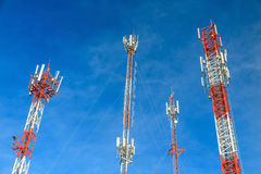 Antenna and cellular tower in blue sky Royalty Free Stock Photos