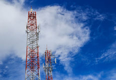 Antenna and cellular tower in blue sky Stock Images