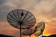 Antenna. Communication satellite dish over sunset sky Royalty Free Stock Photography