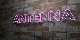 ANTENNA - Glowing Neon Sign on stonework wall - 3D rendered royalty free stock illustration. Can be used for online banner ads and direct mailers Royalty Free Stock Photo