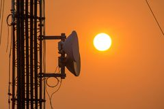 Antenna on a high rise building with sunset time. Antenna on a high rise building With the beautiful sunset evening royalty free stock image