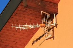 Antenna on house wall Stock Photography