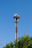 Antenna mast for transmitting mobile. Standing in trees Royalty Free Stock Image