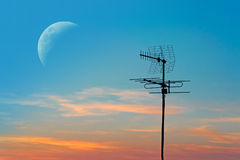 Antenna and moon Royalty Free Stock Image