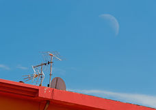 Antenna and moon Stock Image