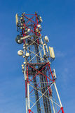 Antenna over blue sky. Red and white antenna Stock Photo
