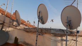 Antenna over italian roofs stock video