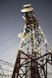 Antenna radio station. Tower on dark blue sky stock photos