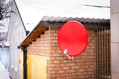 Antenna for receiving satellite TV red royalty free stock photography