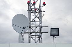 Antenna and red warning lights Stock Photos