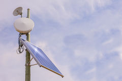 Antenna repeater with solar panel Stock Image