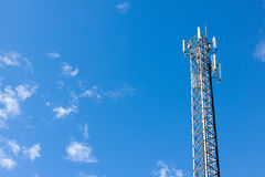 Antenna repeater tower on blue sky.  Royalty Free Stock Images