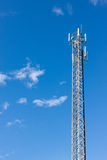Antenna repeater tower on blue sky.  Stock Photo