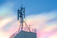Antenna repeater tower on blue sky. Royalty Free Stock Photography