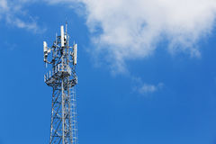 Antenna repeater tower. On blue sky, wireless telecommunication concept Stock Images