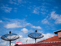 Antenna on the roof with the blue sky background royalty free stock photos