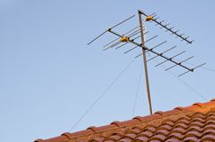 Antenna on the roof. In the house Stock Images