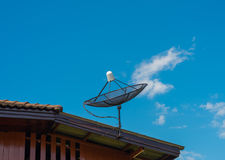 Antenna on the roof of a house. With blue sky royalty free stock photos