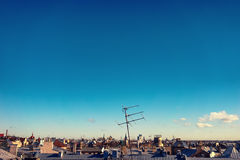 The antenna on the roof of a house in the city Stock Photo