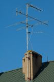 Antenna on the roof. In sunny midday against bleu sky Stock Photos