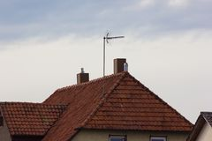 antenna on rooftop of a historical vintage building Stock Photos