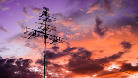 Antenna with sunset. Antena for house where is behind is sunset background royalty free stock photos