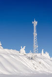 Antenna telecommunications tower covered in white frost Royalty Free Stock Photo