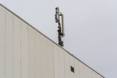 Antenna, telecommunications tower on a roof Stock Image