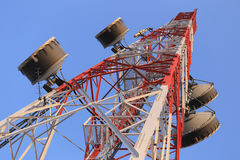 Antenna for Telephone communications in bright sky day time. Royalty Free Stock Images