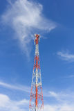 The antenna telephone. Red and white on a blue sky Stock Photos