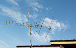 Antenna television. On the roof with blue sky background Royalty Free Stock Photo