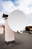 Antenna for television on roof of the building on  Royalty Free Stock Photo