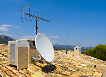Antenna on a Tile Roof. In a small village in Majorca Stock Image