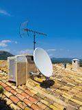 Antenna on a Tile Roof Royalty Free Stock Images