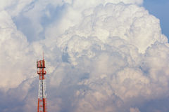 Antenna tower on big cloud background Stock Photo