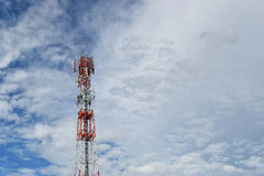 Antenna tower at blue sky and white clouds on a beautiful day. Royalty Free Stock Photo
