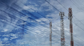 Antenna tower at blue sky and white clouds on a beautiful day. Stock Photos