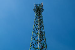Antenna tower. Green antenna tower with gradient blue sky background royalty free stock photography