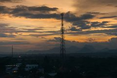 Antenna tower with mountain and sunset background royalty free stock photo