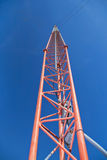 Antenna tower reaching to a clear blue sky Royalty Free Stock Photos