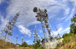 Antenna towers in fish-eye perspective Stock Photos