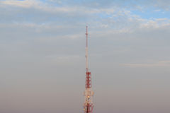 Antenna transmission tower,. Painted white and red in a day royalty free stock photo